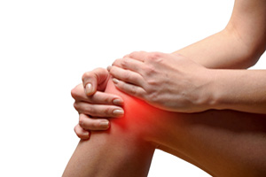 Young woman with severe knee inflammation