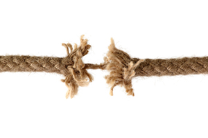 A rope just about to unravel depicting significant psychological stress of victimology