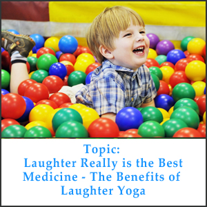 Photo of little boy laughing wilding, lying in lots of colorful, plastic balls.