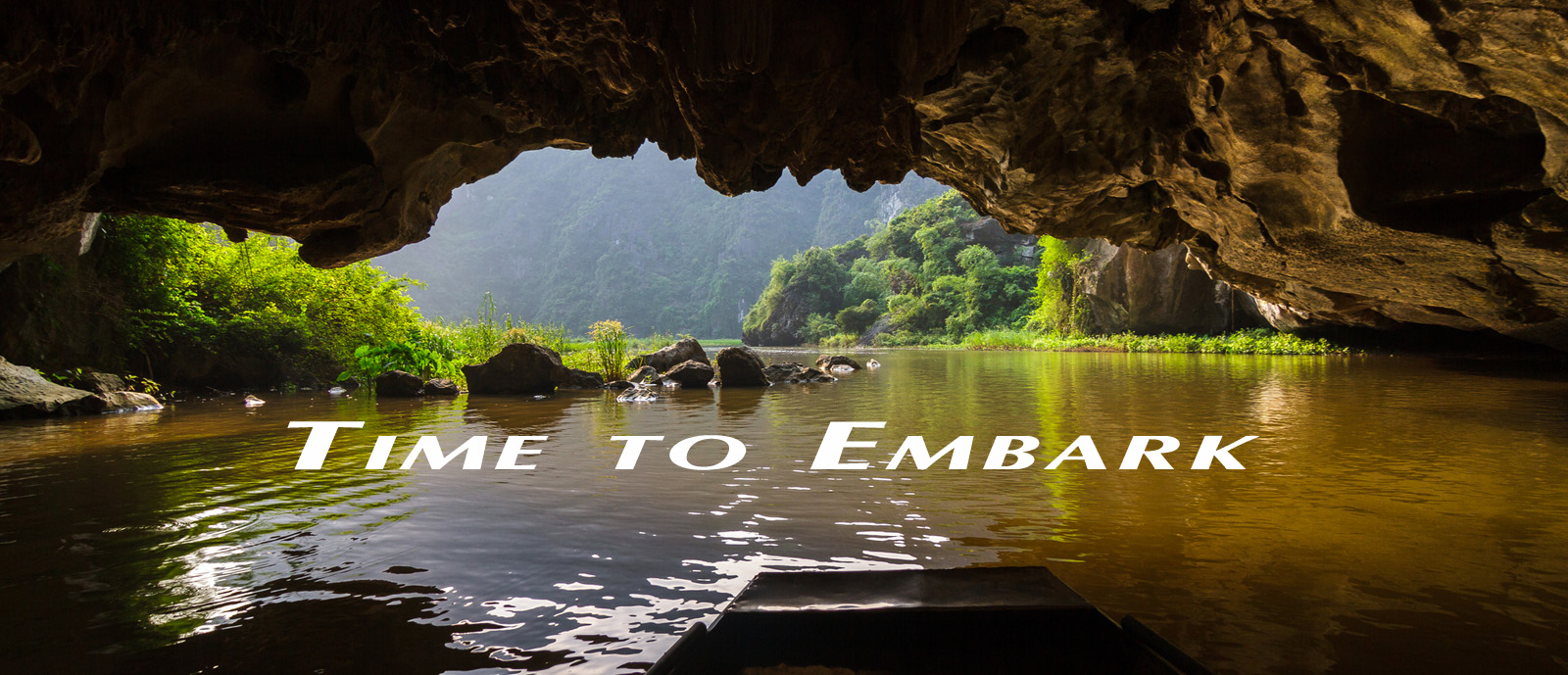 A boat passes through Tam Coc, a flooded cave at the Trang An UNESCO World Heritage site in Ninh Binh, Vietnam, depicting the start of a personal journey of discovery