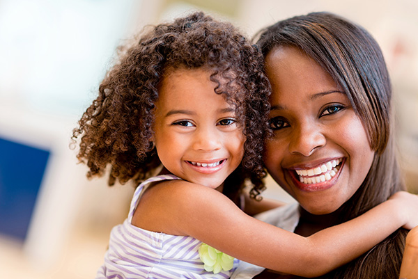 Mother and child, together, happy and smiling